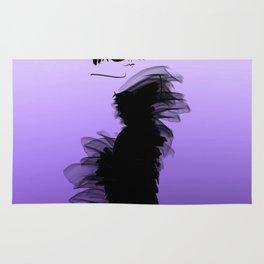 Fashion model in little black dress and violet Rug