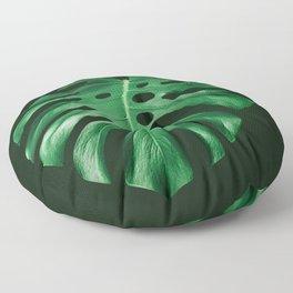 Vivid green monstera leaf on dark background Floor Pillow