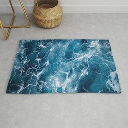 Blue deep sea foaming water - vintage ocean surface background  Rug
