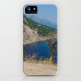 Rocky beach, bue transparent sea in Istria and dry tree, Croatian coast iPhone Case