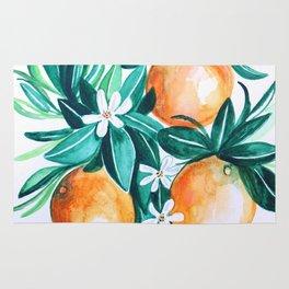 Orange flower watercolor Rug
