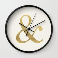 gold glitter Wall Clocks featuring Gold Glitter Ampersand by Tamsin Lucie