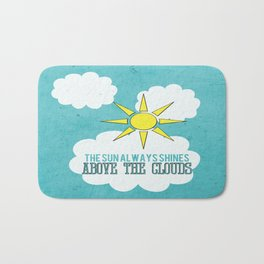 The Sun Always Shines Above The Clouds  Bath Mat