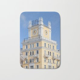 clock on the tower of the building Bath Mat