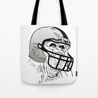 nfl Tote Bags featuring American Football Gorilla by raeuberstochter