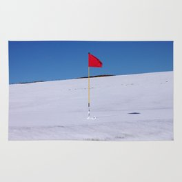 Red flag on Stromness golf course on a snowy April day. Rug