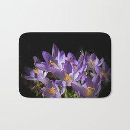 lilac crocus on black Bath Mat