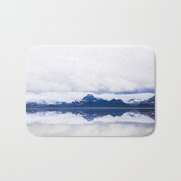 Navy blue Mountains Against Lake With Clouds Bath Mat