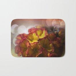 primroses with bokeh -2- Bath Mat