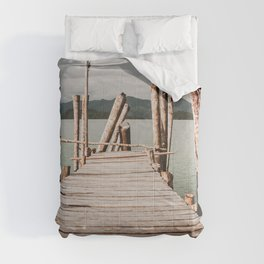 Jetty by the sea, moody view Comforters