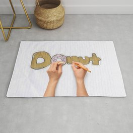 hands drawing a donut Rug