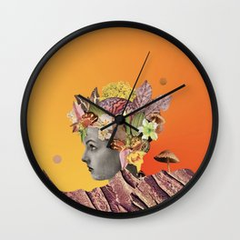 She Moves Mountains with an Orange Glow Behind Her  Wall Clock