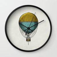 hot air balloon Wall Clocks featuring Vintage Hot Air Balloon by Juste Pixx Designs