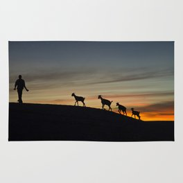 Africa sunset with goats Rug
