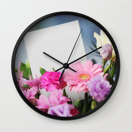 Flowers and a White Sheet of Paper Wall Clock