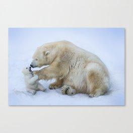 Polar bear with cub. Mother love. Canvas Print