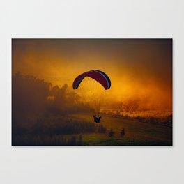 Paraglider Flying Around Orange Clouds Canvas Print