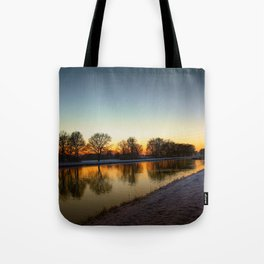 Winter sun early morning waterfront Tote Bag