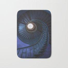 Abandoned blue spiral staircase Bath Mat