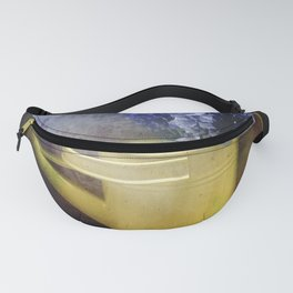 One yellow watering can with violet flowers Fanny Pack