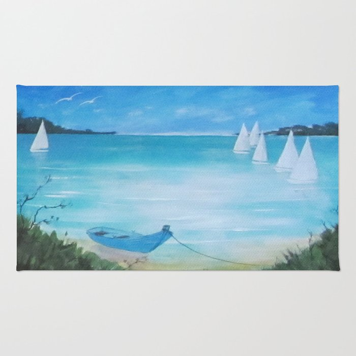 White sails & blue boat moored Rug