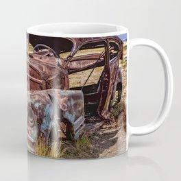 Abandoned car in Badlands ghost town Coffee Mug