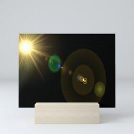 Sun lens flare Mini Art Print