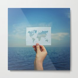 holding the world map Metal Print
