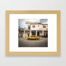 Bright yellow vintage car in La Havana, Cuba. Framed Art Print
