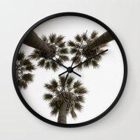 palm trees Wall Clocks featuring palm trees by Joao Bizarro