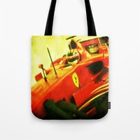 formula 1 Tote Bags featuring Formula 1 team Ferrari by frenchtoy