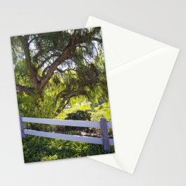 A Tree Next To A White Fence Stationery Cards