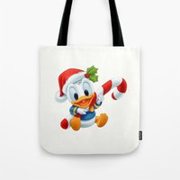 donald duck Tote Bags featuring Christmas baby Donald Duck by Yuliya L
