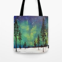 northern lights Tote Bags featuring Northern Lights by Ruth Oosterman
