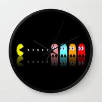 pac man Wall Clocks featuring Pac Man by Emma Kennedy