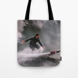 Surfer riding a wave Tote Bag