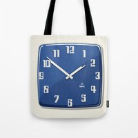 wall clock Tote Bags featuring Wall clock for public facilities HA8 - Iskra by Jus Project
