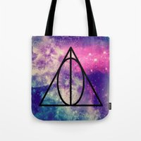 deathly hallows Tote Bags featuring The Deathly Hallows by ClassicalSass