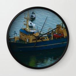 A ship by the sea Wall Clock