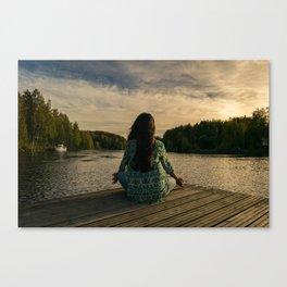 Woman Meditating On Dock By Lake Canvas Print