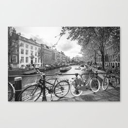 Bicycles parked on bridge over Amsterdam canal Canvas Print