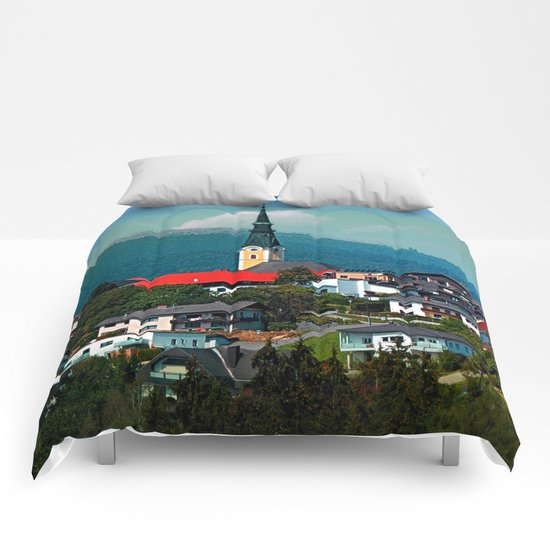 A village in autumn season Comforters