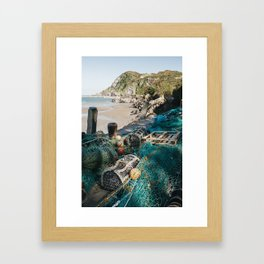 Fishing nets and lobster pots in the harbour at Ilfracombe. Devon, UK. Framed Art Print