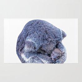koala holding little koala Rug