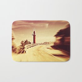 Lighthouse on the road Bath Mat
