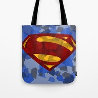 man of steel Tote Bags featuring MAN OF STEEL by thebuffaloarmy