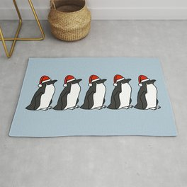 Five Penguins wearing Santa hats Rug