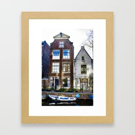 Amsterdam Canal Row Houses with Row Boat Parked in front Framed Art Print