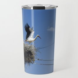 A Stork family in their nest on a telegraph pole. Travel Mug