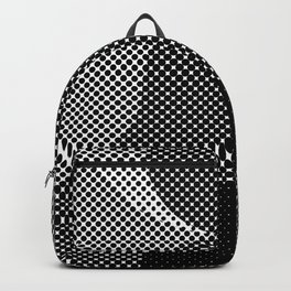 Shadows, mountains, a big eye, all made out of small dots. Black and white. Backpack